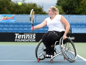 Louise Hunt is pictured striking a tennis ball on court