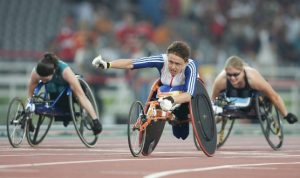 Baroness Tanni Gray-Thompson DBE is pictured crossing the finishing line at the 2004 Paralympics in Athens