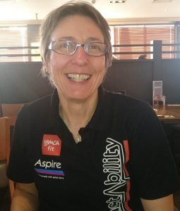 Judith Caulter is pictured smiling wearing glasses